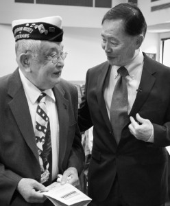 World War II veteran Art Iwasaki talks with George Takei prior to the 2011 Day of Remembrance event.